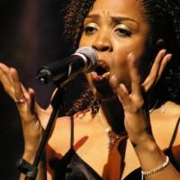 Divine Brown sings
